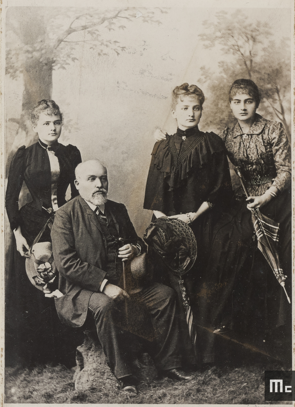 """Wladyslaw Sklodowski and his daughters in 1890 (from left to right: Maria, Bronislawa and Helena)"""